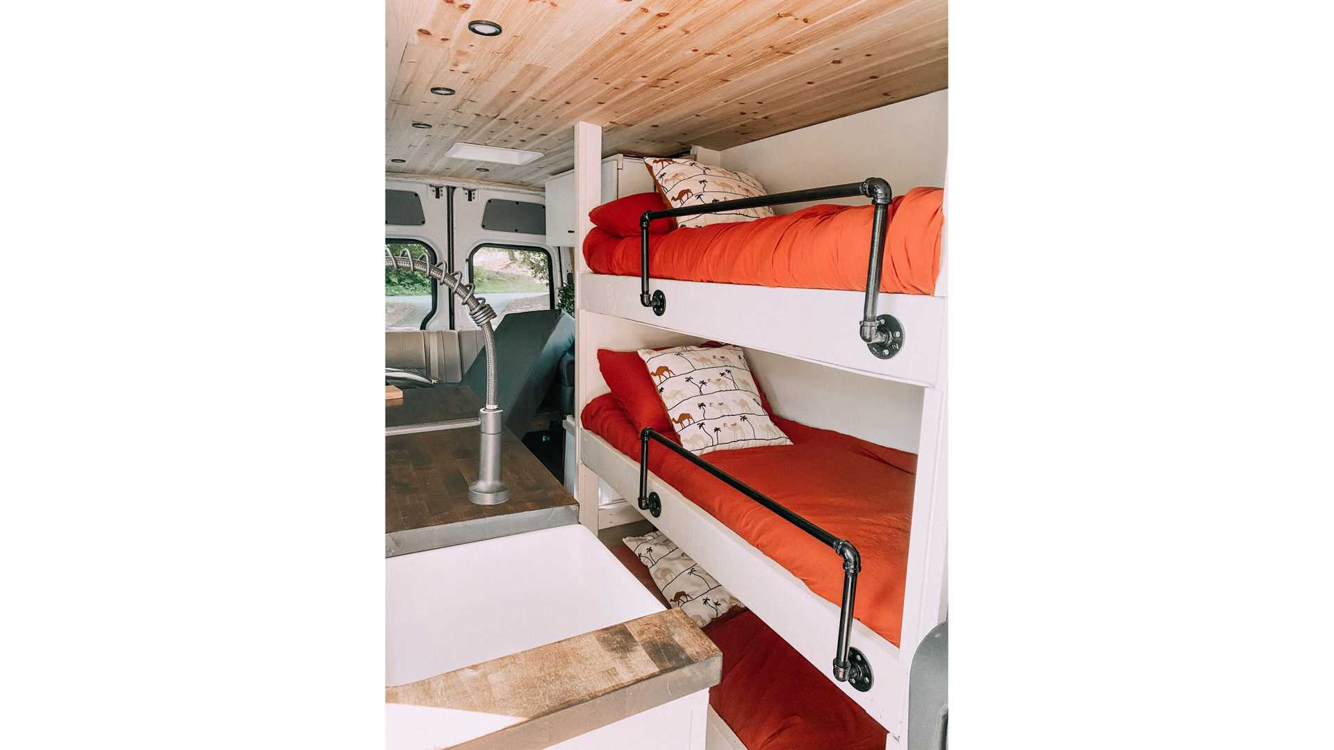 https://cdn.motor1.com/images/mgl/nOZno/s6/family-road-trip-custom-camper-with-bunk-beds-front.jpg